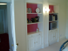 Cupboards and shelves built into alcoves.