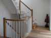 Oak staircase over 3 floors with painted white spindles