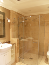Custom made frameless glass shower enclosure. Purpose made sink units
