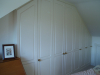 Cupboards built into eaves in loft conversion