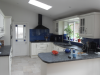 Kitchen extension. Velux roof lanterns for light. Feature glass splash backs